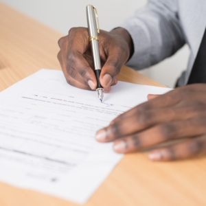 Hand Signing an Agreement