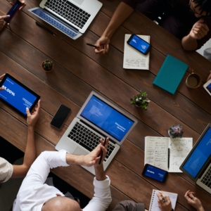 Employees Using Gadgets During Business Office Meeting