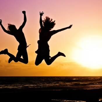 Shadow Jump Shot Picture of Two Woman With Sunset Background
